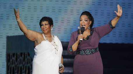Aretha Franklin and Oprah Winfrey acknowledge fans during