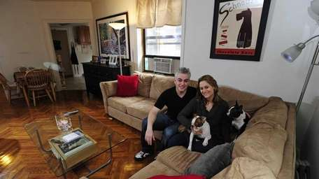 Brian and Jennifer Sapir with their Boston terriers