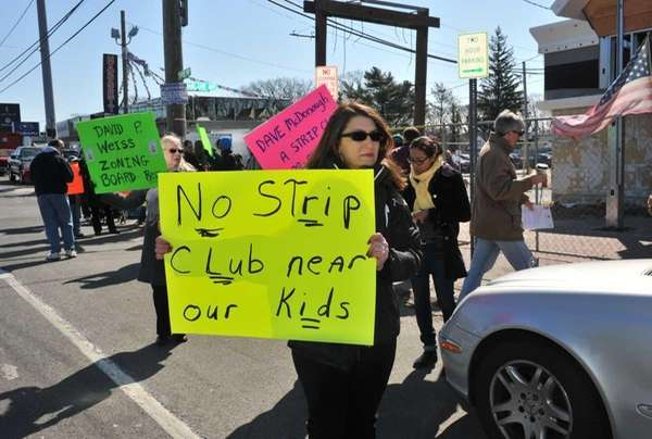 Christy Aceto of Wantagh protests outside the site