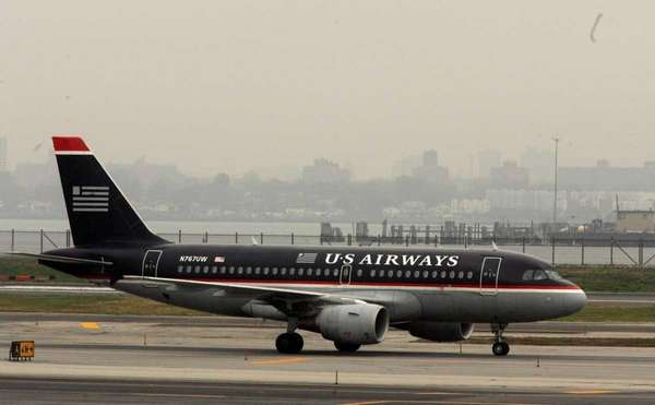 A US Airways jet airplane is seen taxiing