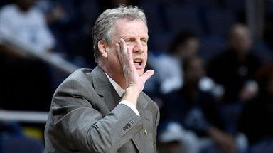 Iona head coach Tim Cluess shouts instructions to