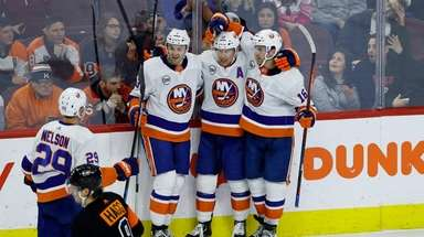 New York Islanders' Andrew Ladd (16), Josh Bailey