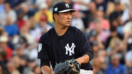Masahiro Tanaka #19 of the Yankees pitches in