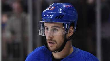 Rangers defenseman Brendan Smith looks on against the