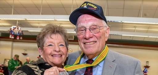 Peter Hanson, 76, with his wife Sherry, shows