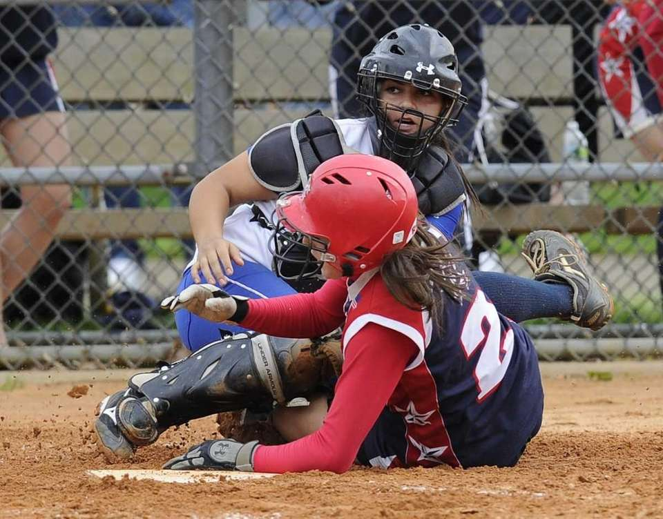 MacArthur's Kristen Brown is safe at home plate