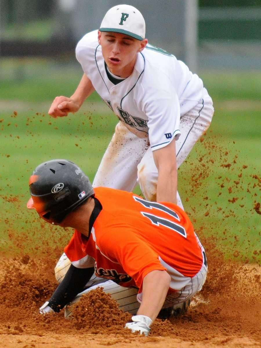 Carey High School shortstop #11 Kyle DeMeo, bottom,