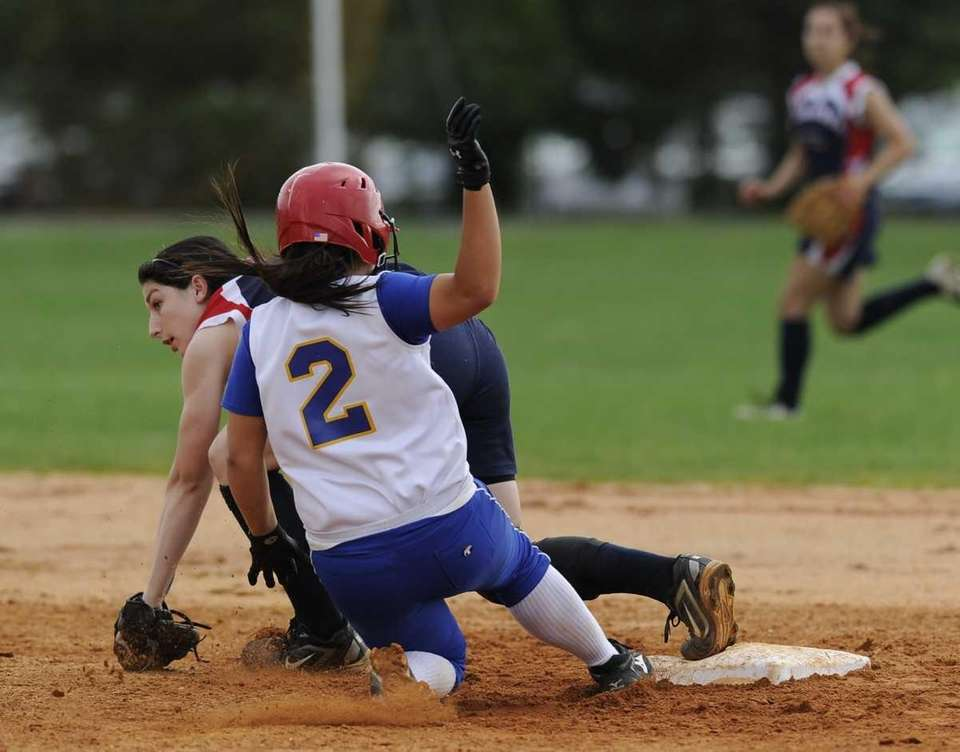 East Meadow's #2 is out at second base
