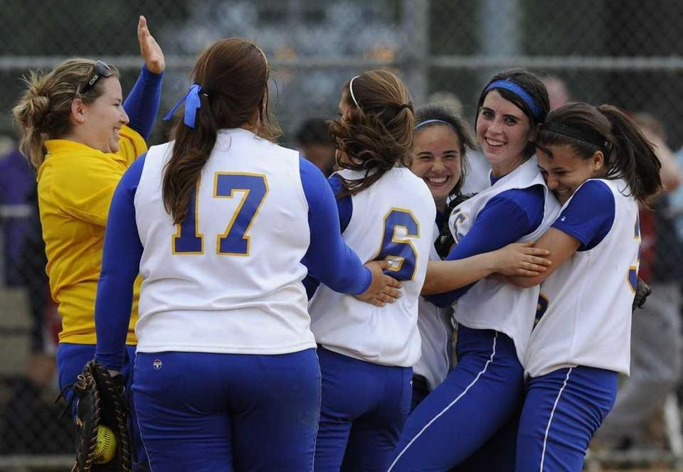 East Meadow teammates celebrate their 9 - 6