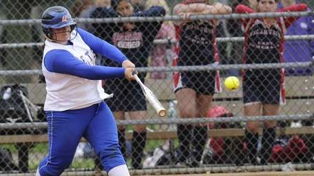 East Meadow's Jaime Laird gets a base hit