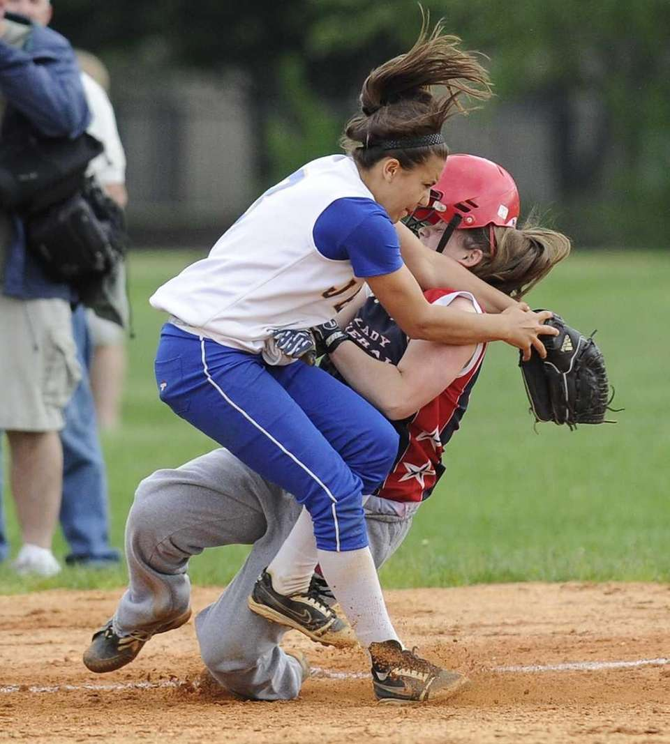 MacArthur's Emily Lyons collides with East Meadow third