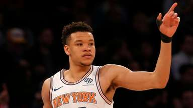 Kevin Knox #20 of the Knicks reacts after