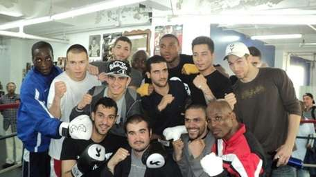 Bernard Hopkins (lower right) poses with boxers during