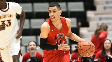Long Island Lutheran's Andre Curbelo (11) moves the