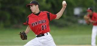 Newfield pitcher Caleb Olesen delivers to the plate