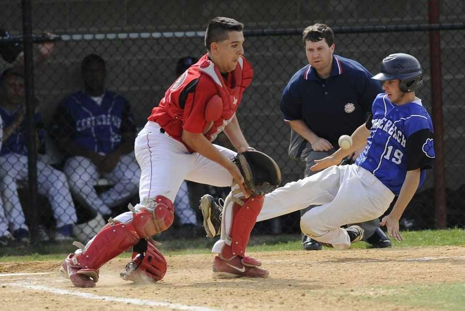 Newfield catcher Tom Gilistro can't handle the ball