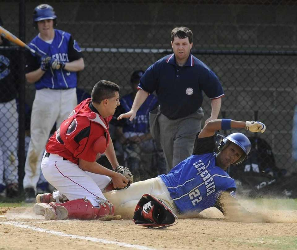 Centereach's Josh Zenon is tagged out at home