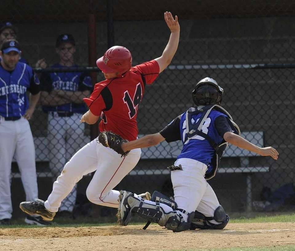 Centereach catcher tags out Newfield's Cory Vogeli at