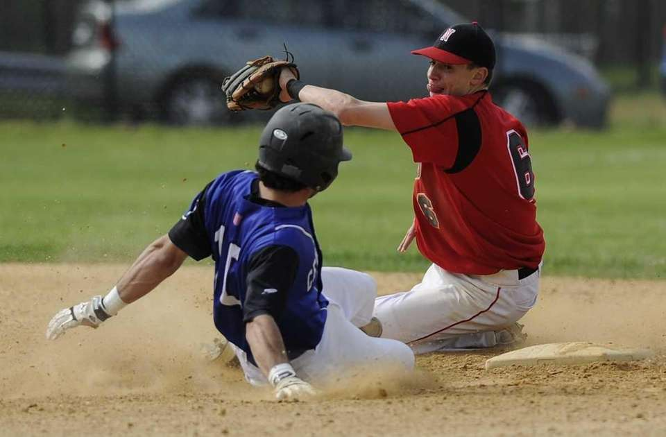 Centereach's Matt Dixon steals second base ahead of