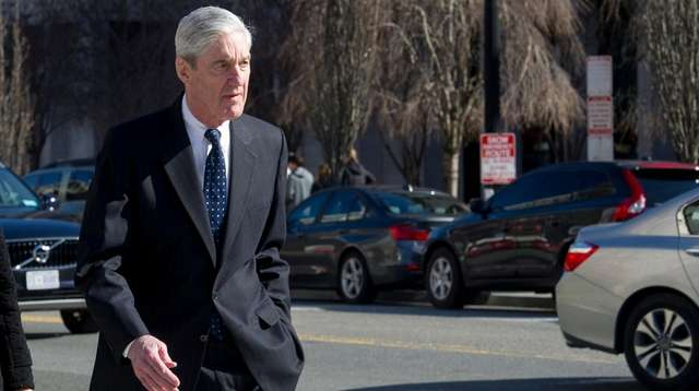 Special counsel Robert Mueller walks to his car