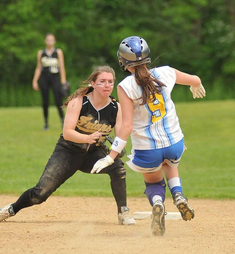 Saint Anthony's infielder Christine Cleary (5, left), is