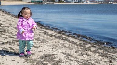 Luana McDonough, 17 months, of Centereach, takes a