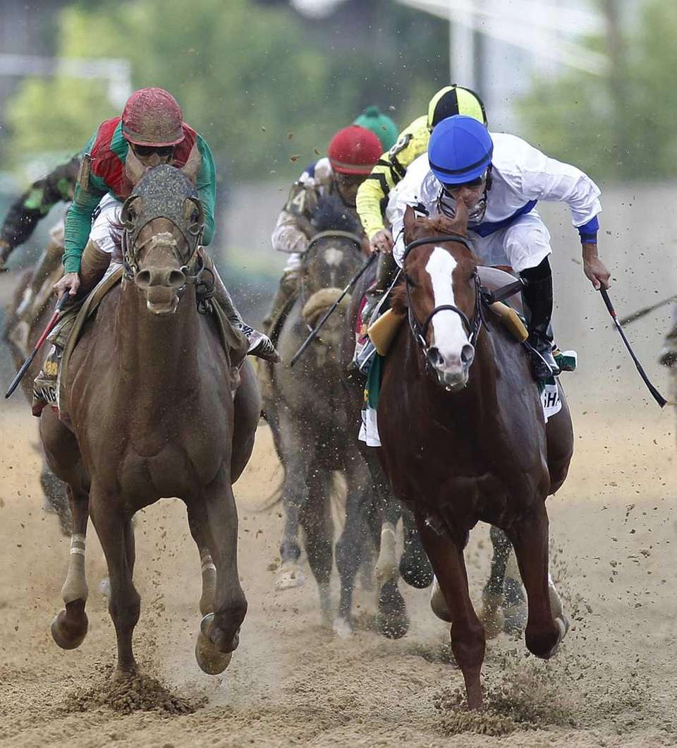 Shackleford, right, ridden by Jesus Castanon, works down