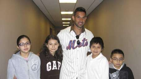 New York Mets outfielder Angel Pagan with Kidsday