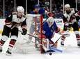 Robin Lehner #40 of the Islanders defends the