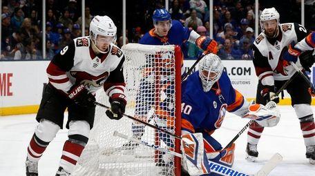 Robin Lehner #40 of the Islanders defends the