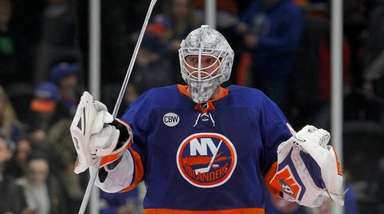 Robin Lehner #40 of the Islanders celebrates after