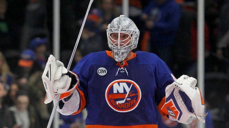 Robin Lehner #40 of the Islanders celebrates after