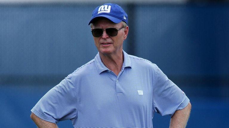 Giants president and CEO John Mara watches training