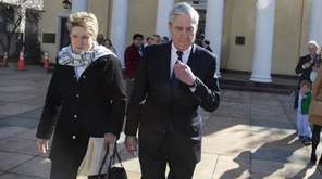 Special counsel Robert Mueller walks with his wife