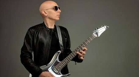 Guitarist Joe Satriani, who grew up in Westbury.