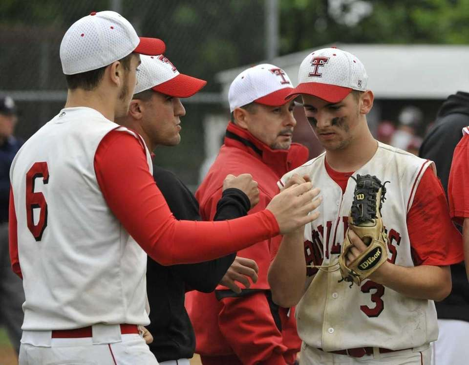 Island Trees pitcher Chris Cutrone is greeted by