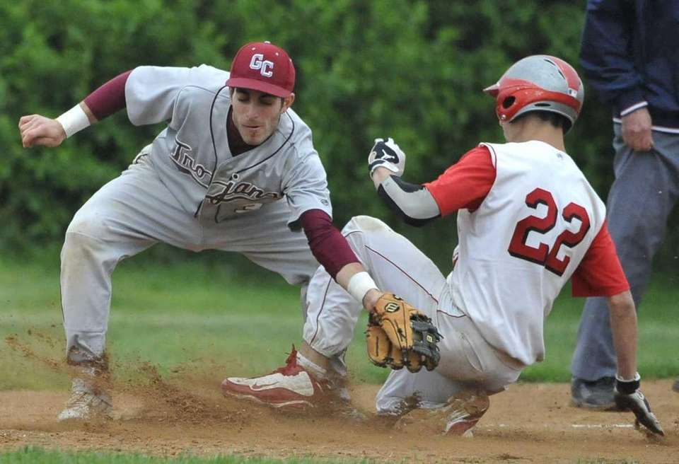 Island Trees' Mike Witteck beats the tag of