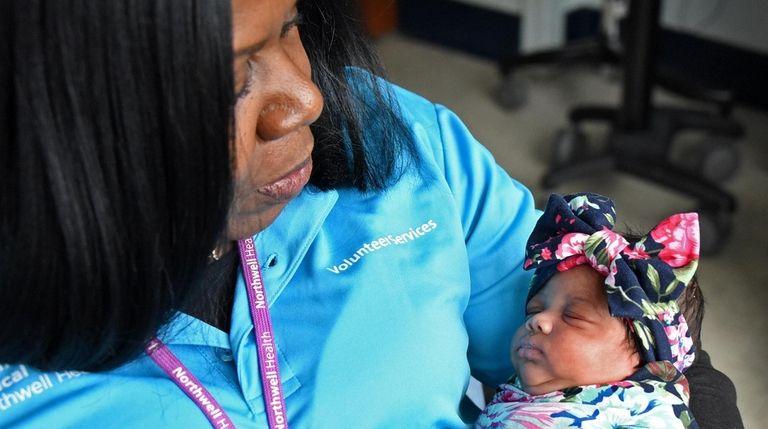 "Letitia Thompson, a volunteer ""cuddler"" at Cohen Children's"