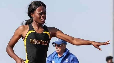 Zaria Fuller of Uniondale reaches for the finish