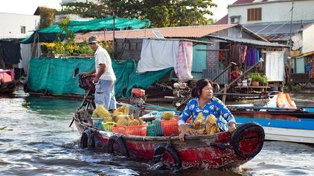 Vendors make their way through the water market