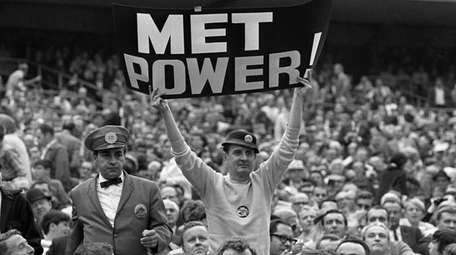 "Mets fan Karl Ehrhardt, known as ""Sign Man,"""