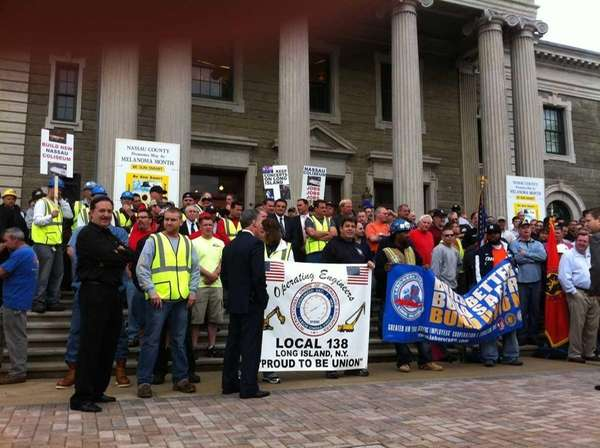 Politicians, fans, merchants and residents rally for the