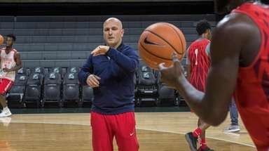 Stony Brook coach Geno Ford puts the players