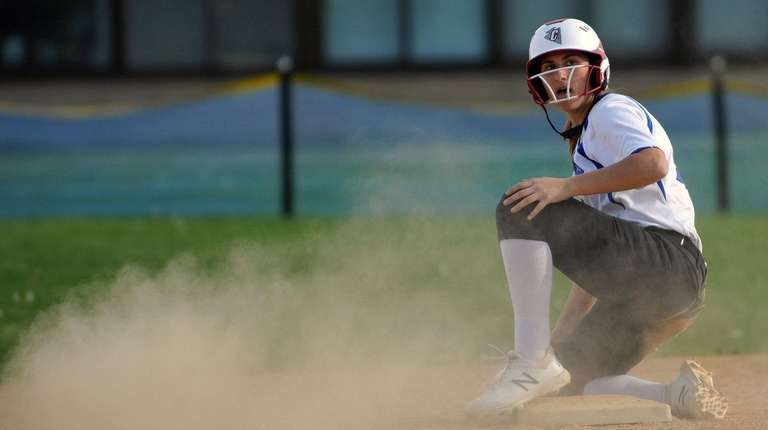 North Babylon's Destiny Schook slides into second base