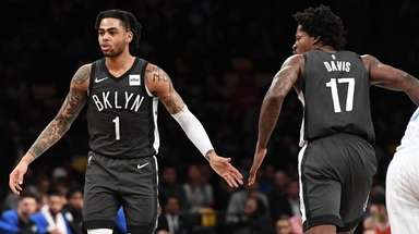 Nets guard D'Angelo Russell (1) slaps five with