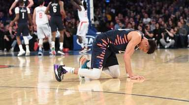 Knicks forward Kevin Knox is down on the
