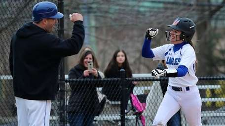 Hauppauge's Giuliana Abruscato is congratulated by her coach