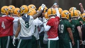 LIU teammates gather during their first football practice