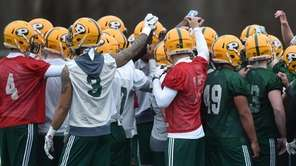 LIU teammates gather during their first football practice