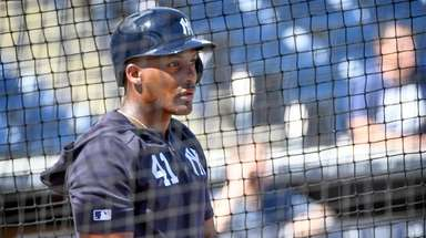 Yankees' Miguel Andujar takes batting practice at George
